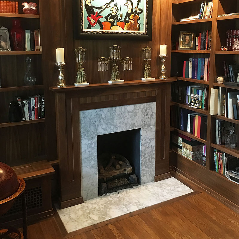 wall shelving and fireplace